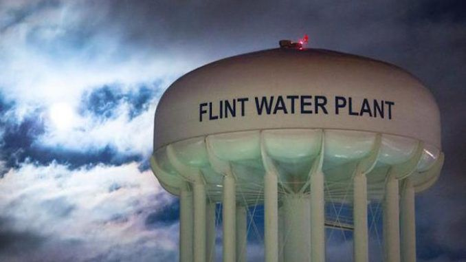 Six more state officials have been charged in connection with the Flint water crisis, as Governor Rick Snyder continues to evade responsibility for the disaster.