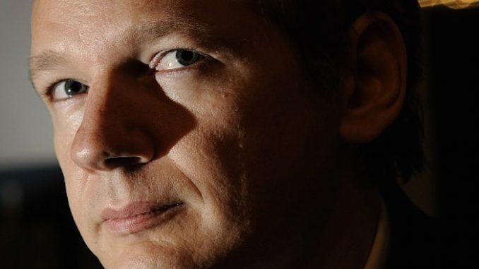 Julian Assange has warned that a Clinton White House will see a merger between the private power of corporations and the military might of the state.