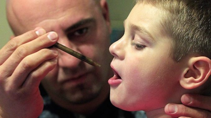 A father has appeared in a video online documenting the rapid progress made by his severely epileptic son while undertaking cannabis extract therapy.
