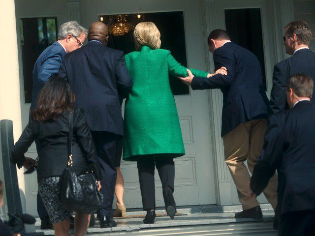 hillary-gets-to-top-stairs