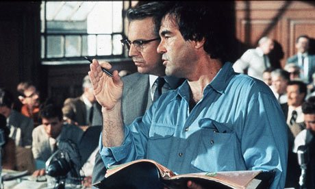 Oliver Stone with Kevin Costner on the set of JFK. Stone said he believed the agent because of his 'jargon' and 'intricate detail.'