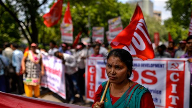 India: Tens Of Millions Strike To Protest Low Wages
