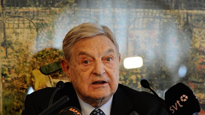 George Soros warns Europeans that they must accept refugees or face extinction