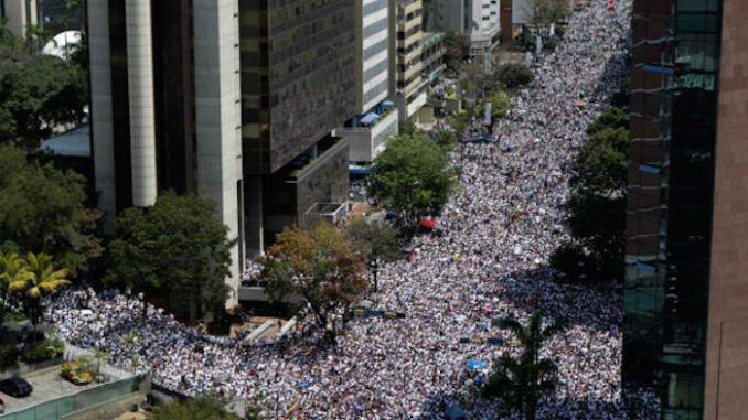 Thousands take to the streets in Venezuela amid a country-wide revolution