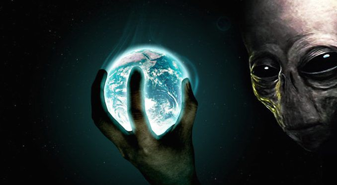 A senior Wall Street banker has claimed that the human race must be paying it's debts to aliens.