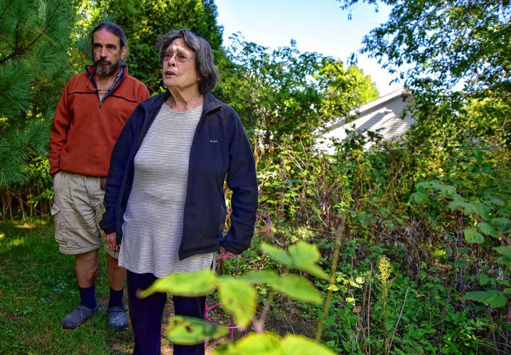 Margaret Holcomb, 81, and her son Tim Holcomb stand where Margaret's marijuana plant was seized by the National Guard and State Police.