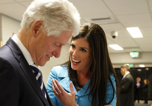 Bill Clinton autographs items as Kathleen Kane, then democratic candidate for Pennsylvania Attorney General, spoke at Upper Moreland High School in 2012. Bill Clinton endorsed Kane earlier that day.