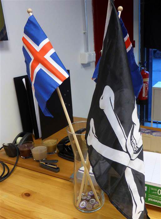 The Pirate Party flag next to the Jolly Roger.