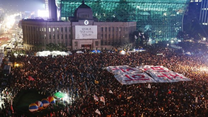 South Koreans are rising up in their millions and demanding the overthrow of a covert shadow government running their country.