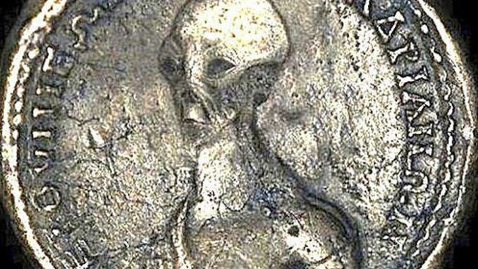 The discovery of an ancient Egyptian coin depicting an alien-like creature is proof that UFOs and aliens have visited Earth, researchers say.