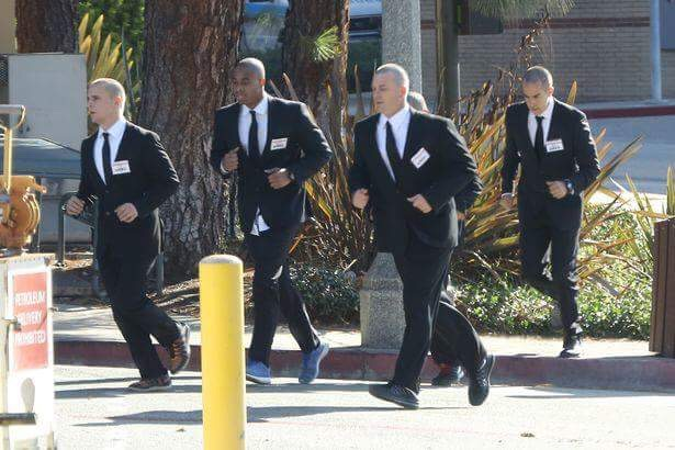 A member of Kanyr's security detail (pictured) disturbed a man with a gun who Kanye claims was going to kill him.