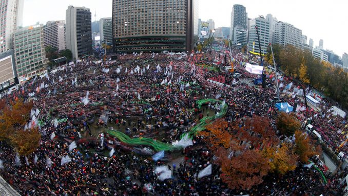 100,000s Protest In South Korea To Demand President Resign