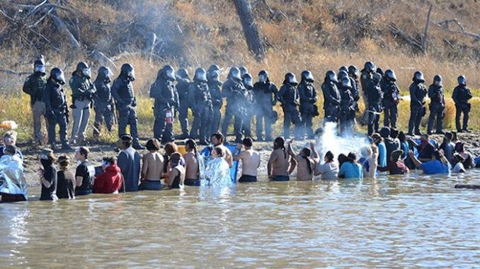Native Americans at Standing Rock, North Dakota are being sprayed with chemical weapons, according to protestor Candida Rodriguez Kingbird.