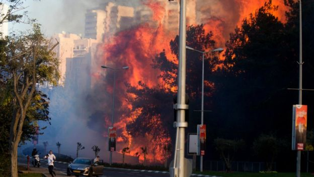 Huge flames roared between apartment blocks as residents fled