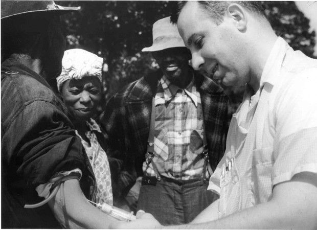 Photo of a doctor drawing blood from a Tuskegee test subject.