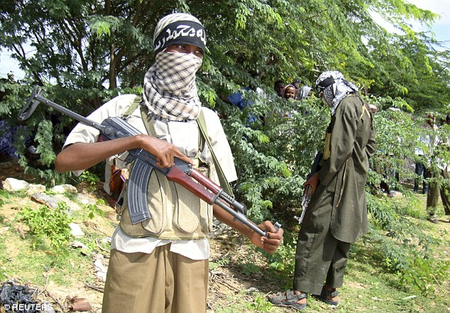 'The public will be deeply concerned that their hard-earned cash is literally being handed out to terrorist organisations'. Pictured, Al-Shabaab fighters in Mogadishu