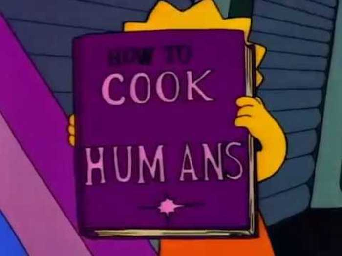 Lisa Simpson holds up a Marina Abramovic style spirit cooking cookbook