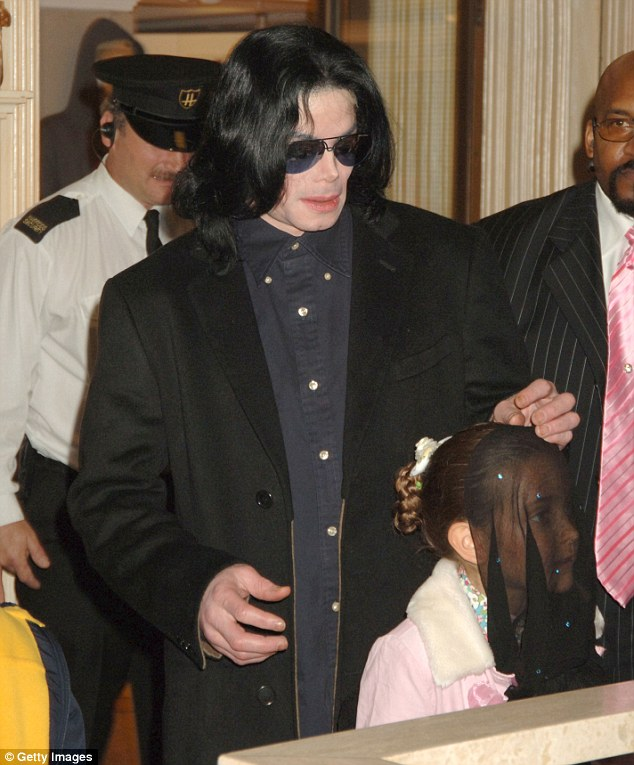 """Paris, pictured with her father Michael in 2005 in London, said he would often drop hints that a group """"more powerful than the government"""" were out to get him."""