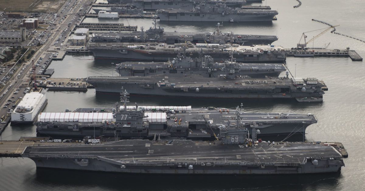 Obama recalls all aircraft carriers back to port, potentially setting up the USA for an attack