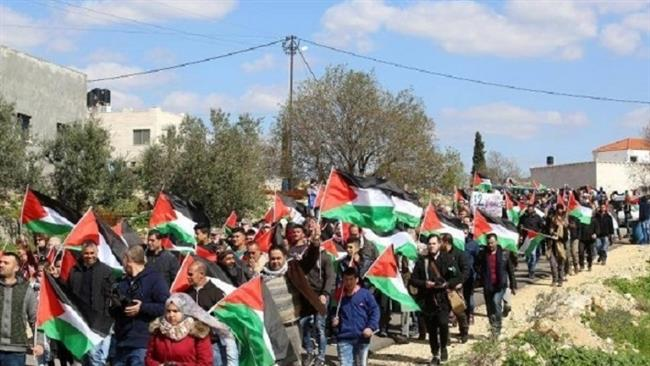 Palestinians stage an anti-Israeli demonstration in Bil'in near the West Bank city of Ramallah on February 17, 2017. (Photos by Ma'an)