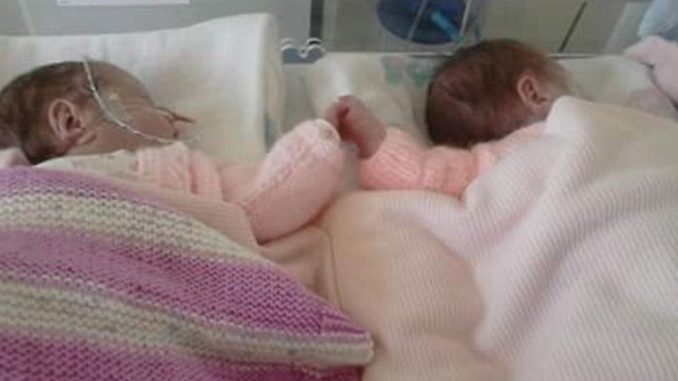 A pair of identical twins, aged just 3 months, were found dead shortly after receiving 'routine' vaccinations by a doctor.