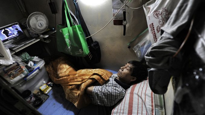 Hong Kong resident live in 'coffin homes' as housing crisis worsens