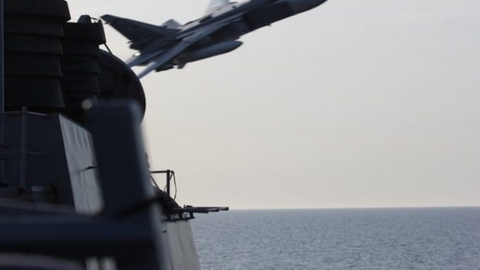 Russian fighter jet shoots at US destroyer putting military on 'red alert'