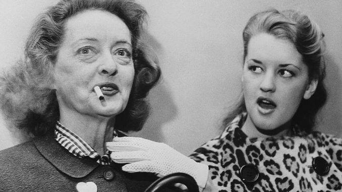 Bette Davis' eldest child, born-again Christian, B.D. Hyman, claims her famous mother practicing witch who put 'demonic' curses on her enemies and family.