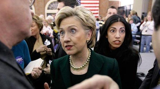 Two of Huma Abedin's cousins have been arrested and she has been named, along with Hillary Clinton's State Department, in a US Department of Justice prosecution