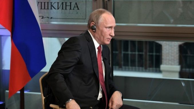 Putin says that men in dark suits control Washington and that all US presidents are really just puppets