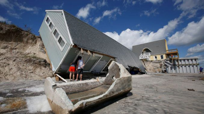 An MIT economics professor warns that mortgage defaults resulting from hurricane damage will send the world into another global recession.