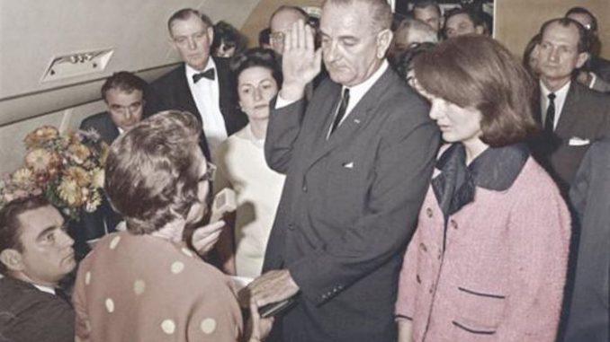 """Jackie Onassis wore her bloodstained dress to Lyndon B. Johnson's emergency swearing in ceremony """" to shame"""" him, according to the JFK files."""