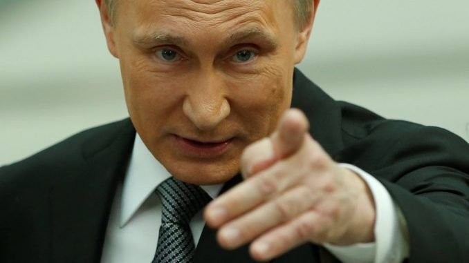 Putin accuses US of hacking Russian elections