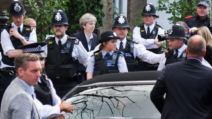 Theresa May's government in collapse after huge porn raid