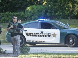 Four armed police officers from Broward County Police may have been ordered to stand down from intervening in the Parkland school shooting, according to reports.