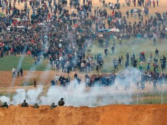 Thousands of Palestinians clash at Israeli border