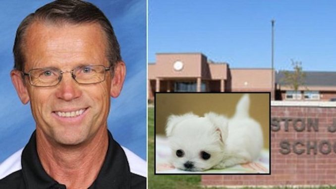 A science teacher in Idaho is under investigation after he was caught feeding a live puppy to one of his pet reptiles in front of students.