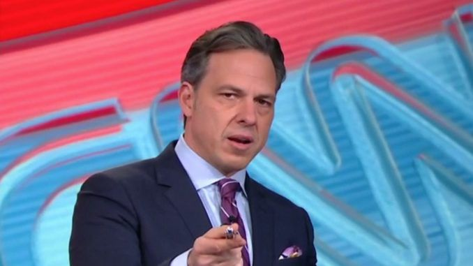 CNN reporter Jake Tapper has been implicated in a political espionage scandal after a House Report linked him to a DNI leak.