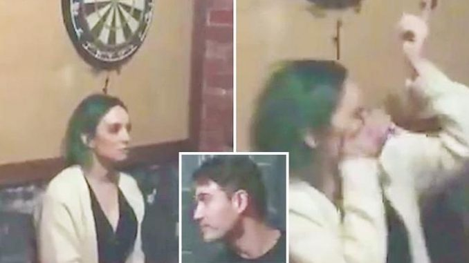 A video shows a young woman getting a dart in the eye after repeatedly daring her boyfriend to throw it at a dartboard just above her head.