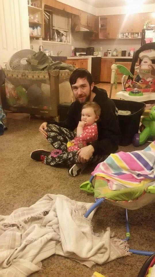 Daddy with Zoey in untidy, just-moved-in home.