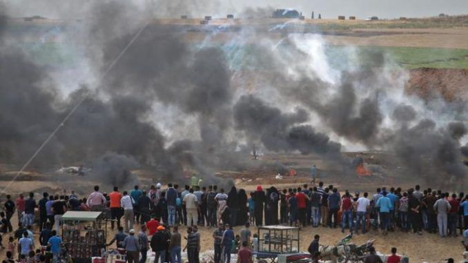 """Israel continued its violent repression of Palestinian protesters on Monday when soldiers once again gunned down unarmed demonstrators, killing 41 and wounding 1,700, after """"smallgroups"""" of Palestinians allegedlythrew stones at them."""