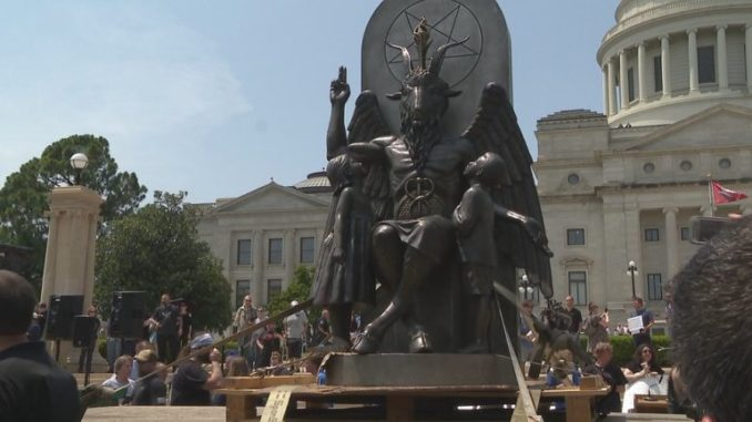 "A giant goat-like statue of Baphomet was unveiled Thursday on the lawn of the Arkansas State Capitol in Little Rock in front of a baying media pack and supporters who chanted ""Hail Satan."""