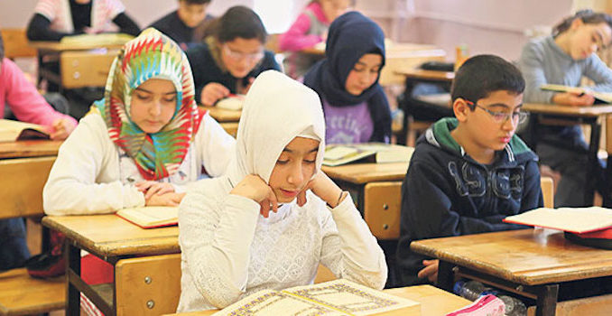 A German school headmaster in Frankfurt-am-Main told the mother of a student she should dress her daughter in a hijab, or Muslim head covering, so that Muslim students would stop bullying the girl.