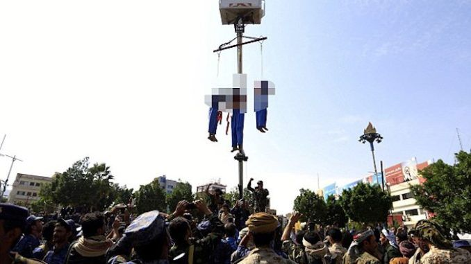 Three pedophiles were publicly executed and hanged from cranes after they were found guilty of brutally raping and killing a 10-year-old boy.