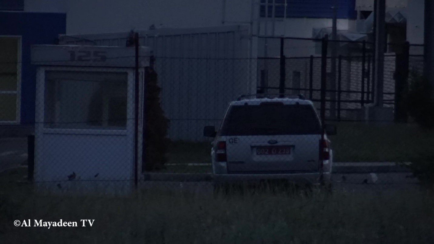A diplomatic car with US Embassy registration plates can be seen in the car park of the Lugar Center at night when the laboratory is seemingly still working.