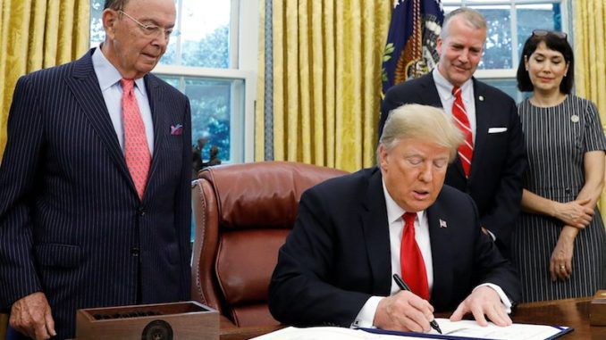 President Trump has signed a landmark new bill to introduce legislationthat will clean millions of tons of garbage from the world's oceans.
