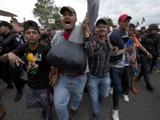 Mexican Police were fired upon by two armed Honduran migrants this week as they attempted to provide security for the notoriously unsafe caravan.