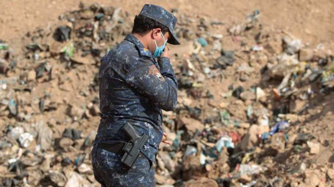 UN investigators discover mass graves containing bodies of 12,000 dead women and children in Iraq