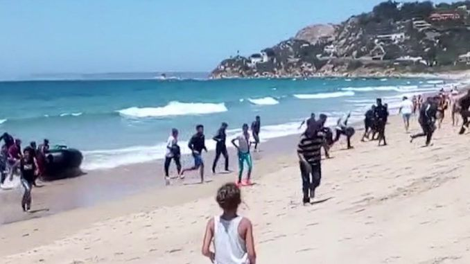 A young Muslim refugee who had just obtained protected status in Italy after crossing the Mediterranean Sea by boat has been arrested on suspicion of raping a grandmother on a beach.