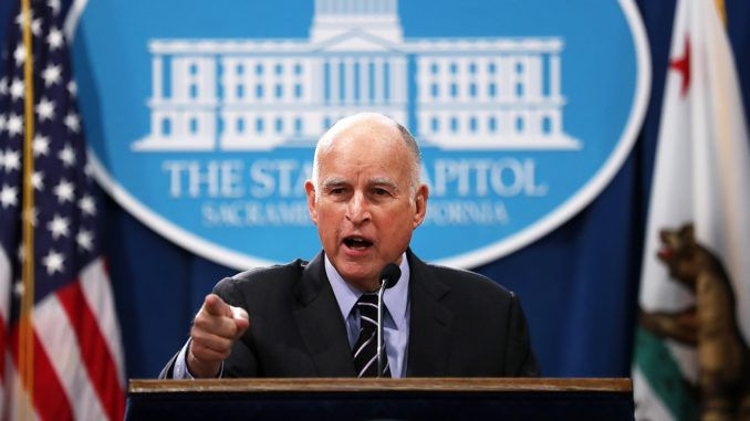 Gov. Jerry Brown says global warming is to blame for California wildfires spreading through the state